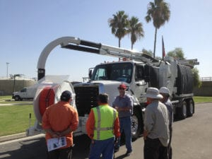 Workers Demonstrating a Super Products Truck