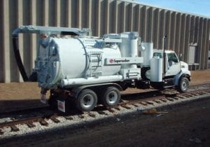 Supersucker High Rail Vacuum Truck on Railroad Tracks