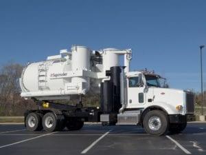Supersucker High Dump Vacuum Truck Parked Outside